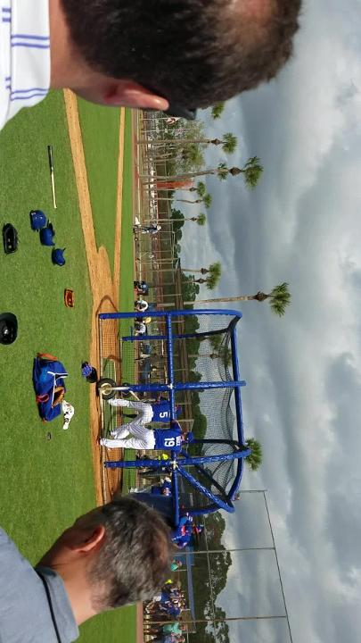 David Wright swings during the Mets' first full team workout of spring training.