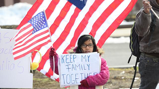 Immigrants and Americans marching in solidarity to protest the immigration policy of President Donald Trump.