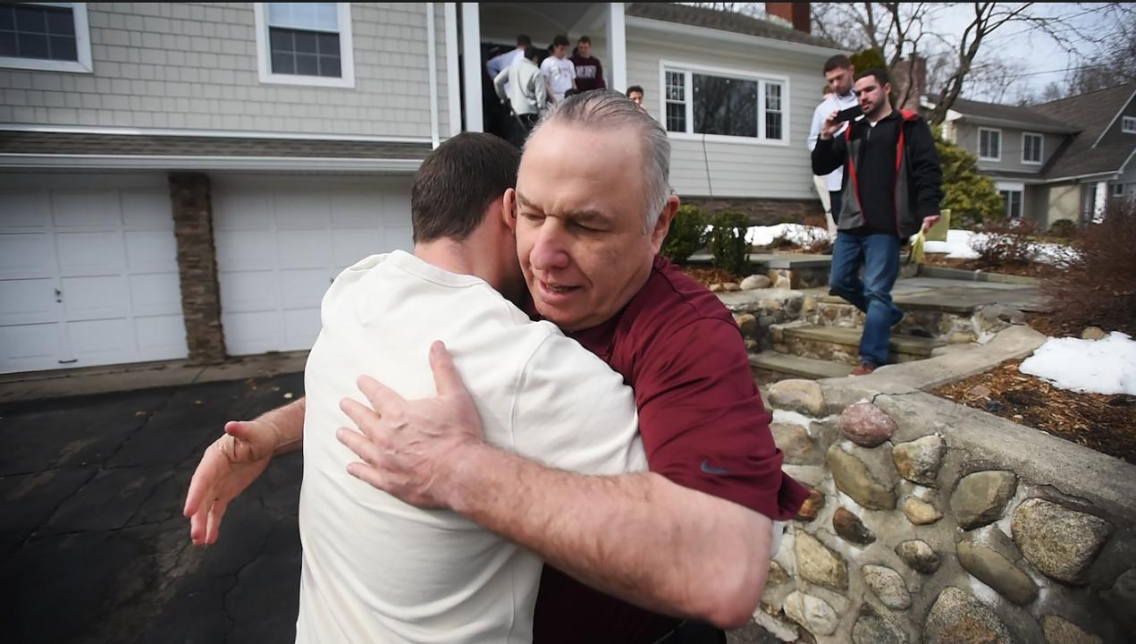 A group of current Don Bosco Prep football players and supporters visit their former coach Greg Toal at his house on Sunday morning as a show of support for their coach, who they feel was wrongly forced to resign by school officials.