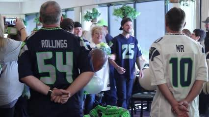 Rob and Teresa Muhlhausen celebrate their wedding ceremony with a Seahawks theme Saturday, September 10, 2016.