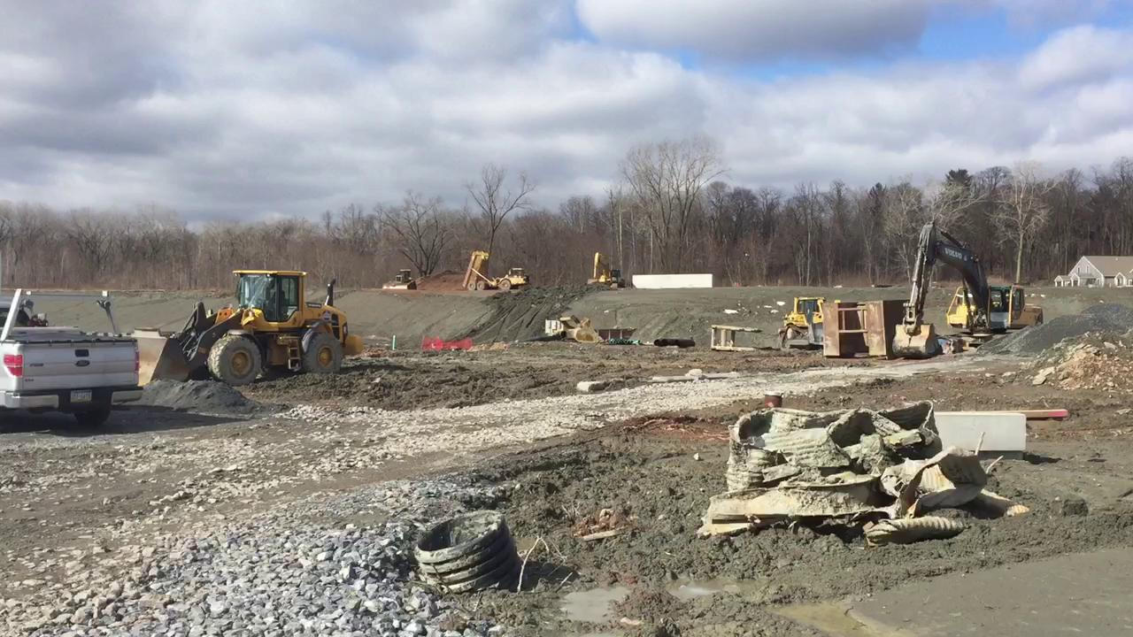 Heavy equipment is scattered on a 20-acre parcel of land at the Aspens Business Park where a new Northwest Elementary School is being built.