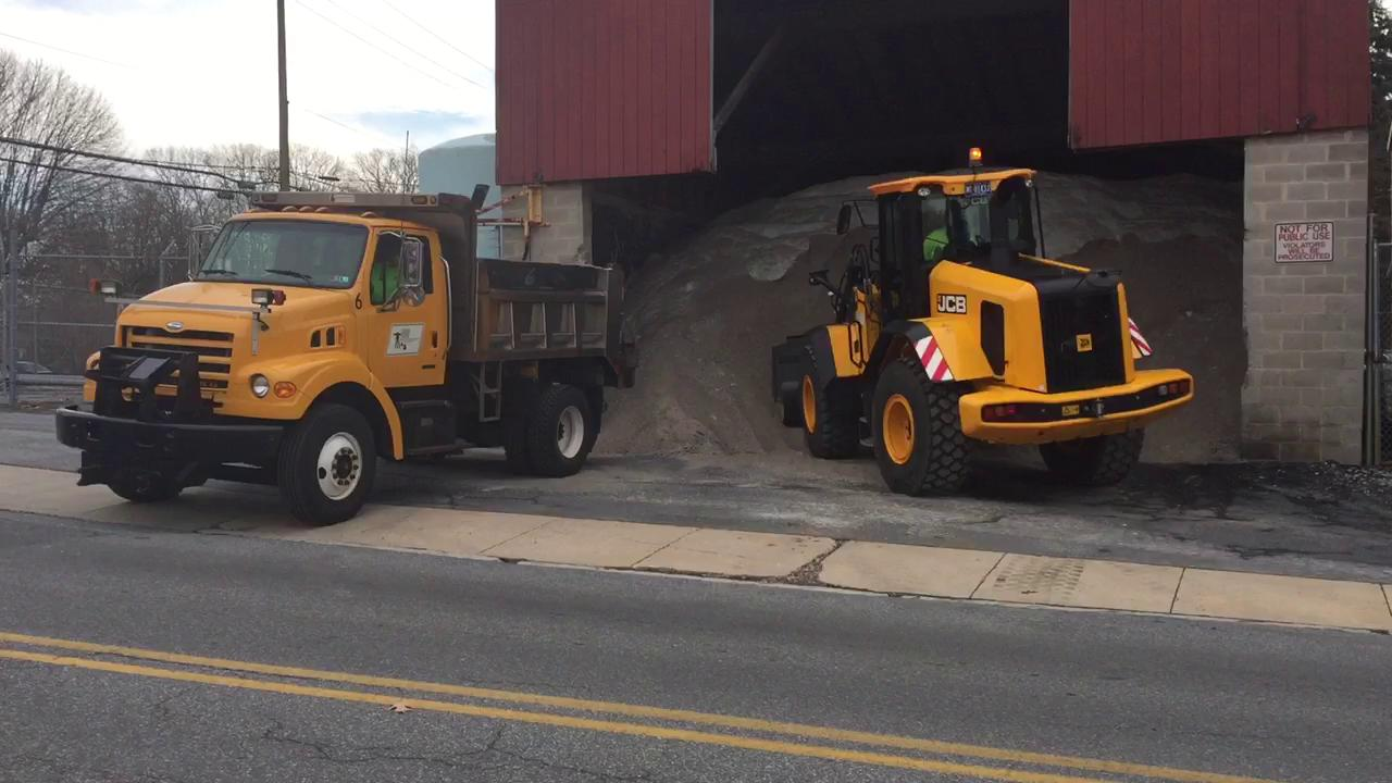 The driver of a front end loader fills a  dump truck with anti-skid material in preparation for a winter storm that forecasters predict could bring as much as 8 inches of snow to Lebanon overnight Wednesday.