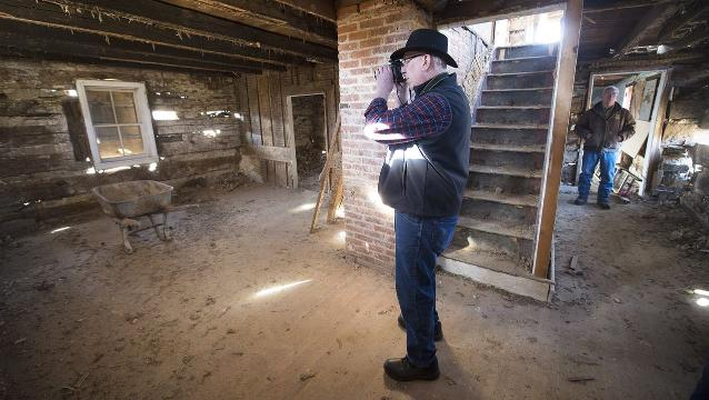 Watch: 1700s log home history explored during demolition