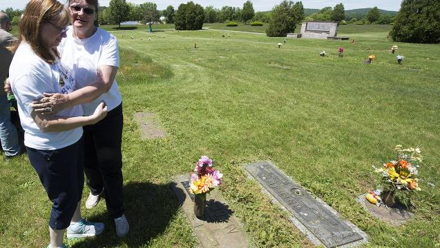Loved ones pitch in to mow forgotten cemetery
