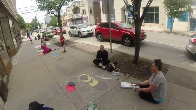 Watch: walking in a chalked up downtown