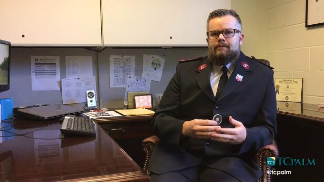 Salvation Army lieutenant Jonathan Needham talks about the anonymous gift of a Spanish gold coin to the Salvation Army Saturday, Dec. 24, 2016.