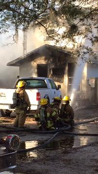 Firefighters battle a house fire on North Hickory Street in Fellsmere, on Saturday, Dec. 31, 2016.