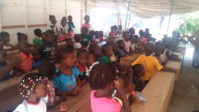 Students sing during Ezra Visions Ministry summer camp in Onaville.