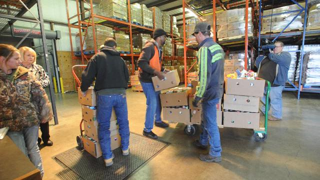 """CityLink employees donate 12,458 pounds of food raised by the CityLink """"Food for Fares"""" fundraiser to the Food Bank of West Central Texas. In addition CityLink presented a check for $1783."""