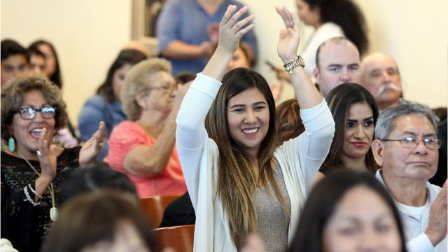 150 new U.S. citizens are sworn in