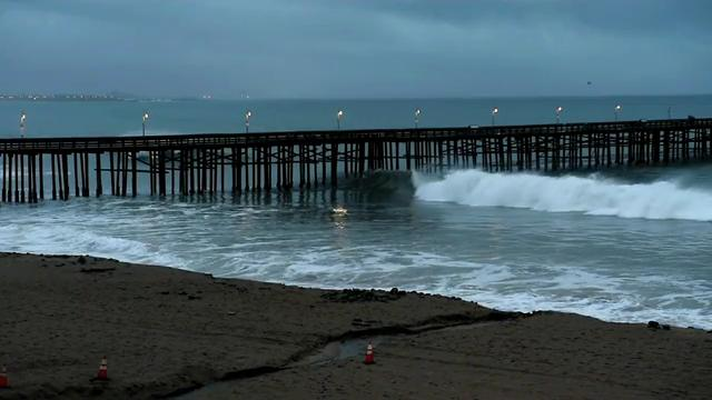 A storm that brought rains to Ventura County early Friday came in with large swells hitting beaches in Ventura.