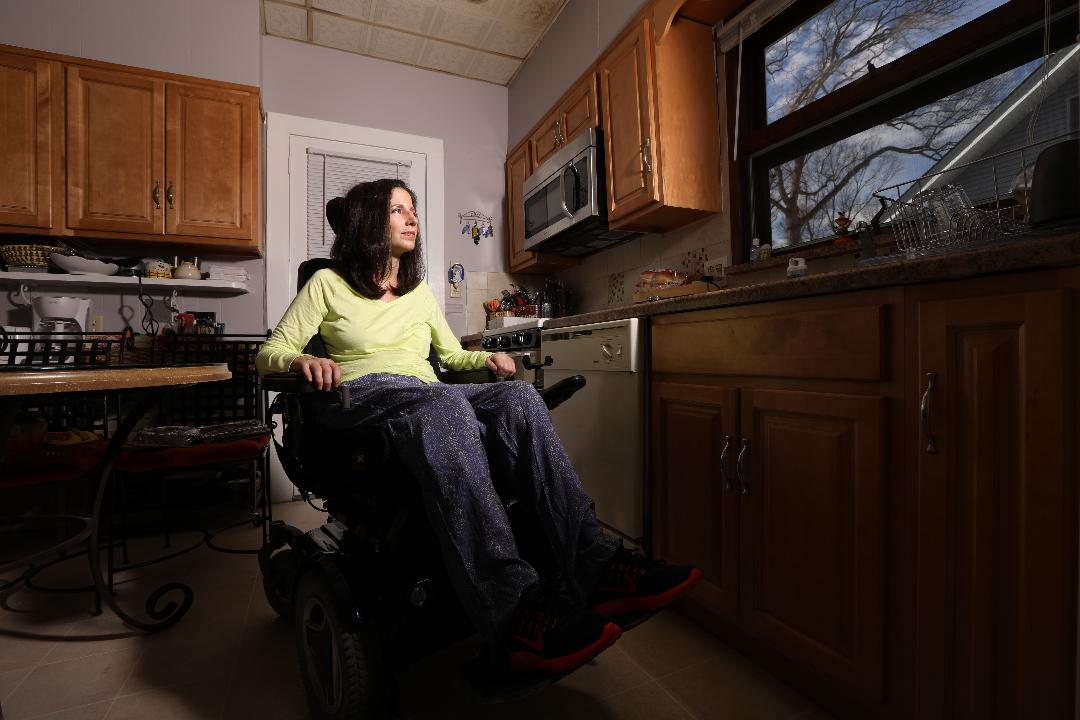 Christine Danza, 44 of Hawthorne fell in her kitchen in December and is partially paralyzed. A zumba event will take place on March 26 to help raise money for her.