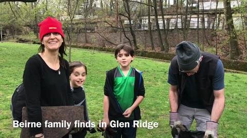 From left, Marion Tamde, Cormac Beirne, 8, Theo Beirne, 11, and Chris Beirne talk about their finds at an Earth Day cleanup in Glen Ridge Saturday, April 22, 2017.