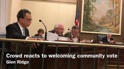 """The audience applauds a vote by the Glen Ridge Borough Council designating the municipality a """"welcoming community"""" during an April 24, 2017 meeting."""