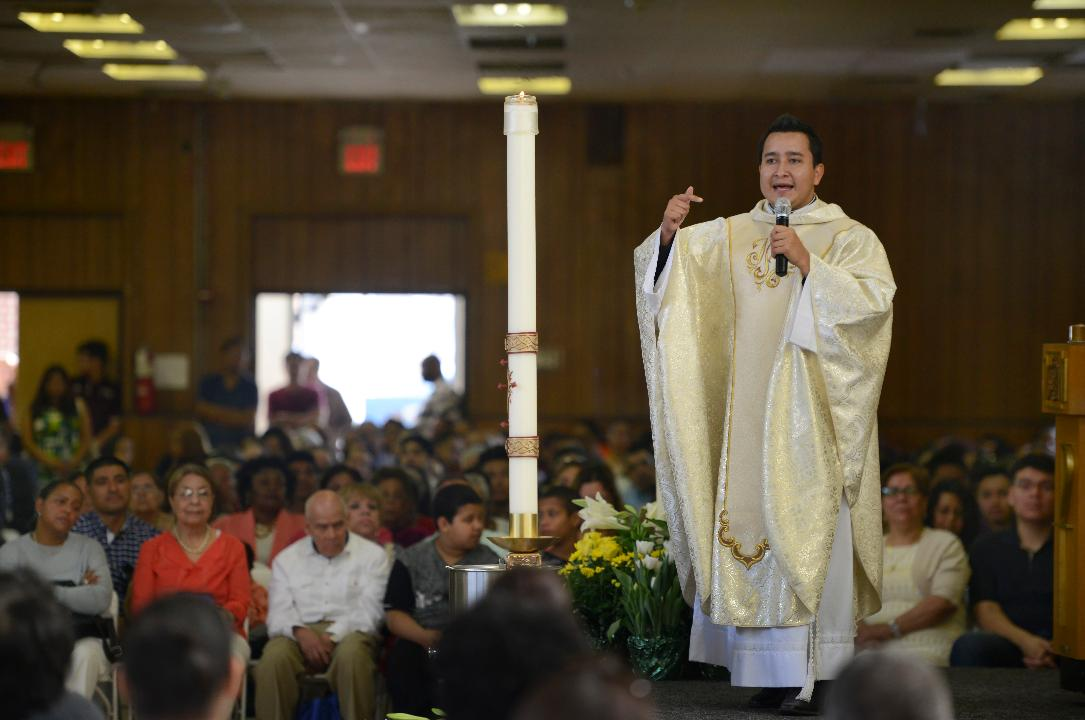 Three days after a calamitous ceiling collapse, hundreds of parishioners gathered for Easter services, which were held at the St. Anthony parish hall, across the street from the severely damaged church.