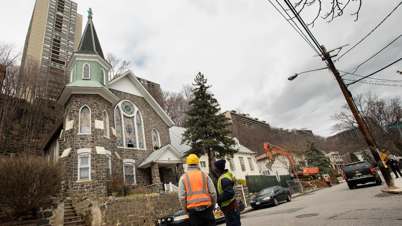 On Wednesday, April 05, 2017 workers demolish the annex of Lord's Grace Church in Edgewater, NJ.