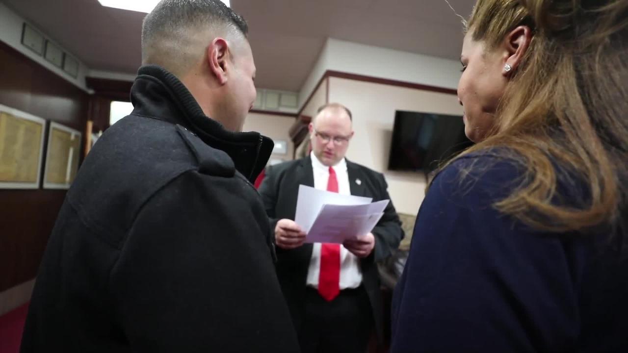 Hazleton, Pa. Mayor Jeff Cusat marries immigrants Anthony and Shamanya Sanatana.