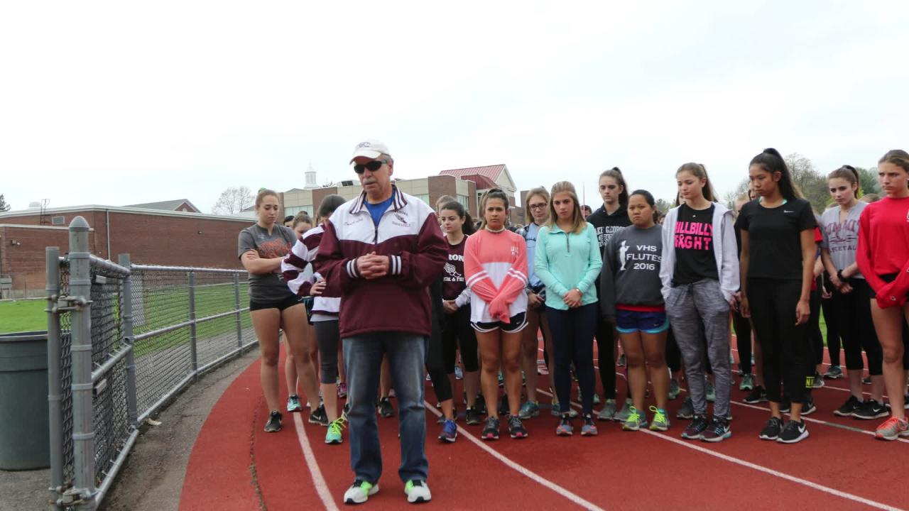 Track and field coach Gene Leporati leads his Verona team in a walk around the track Thursday, April 19, 2017 for Tom Fleming.  Fleming died of a heart attack he suffered at the track Wednesday. Leporati, of Wayne, knew Fleming for about 40 years.