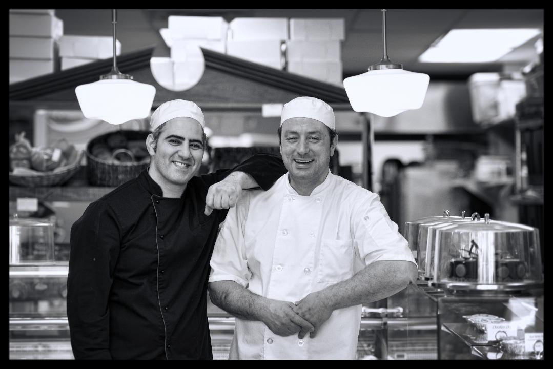 Two bakery chefs Pierre Chayene & Michel Kory work in the kitchen at their bakery store in Elmwood Park.