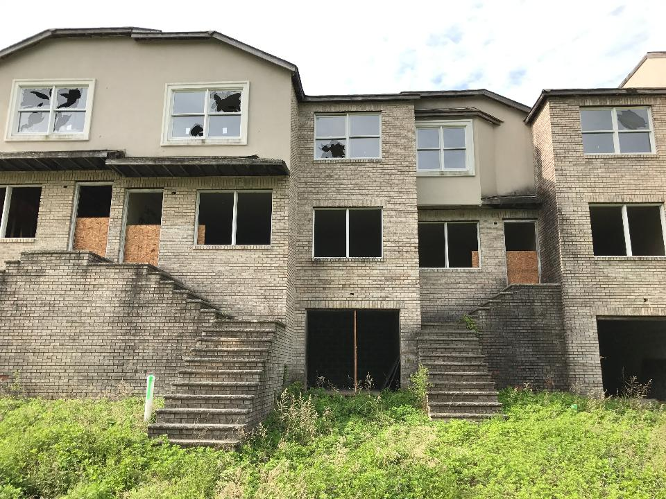 The owner of the abandoned Lakeside Manor townhouses agreed to demolish them after walking away from the project 15 years ago. Three nearby abandoned homes, part of the unfinished Mountain Lakes Estates project, will also be demolished if necessary.