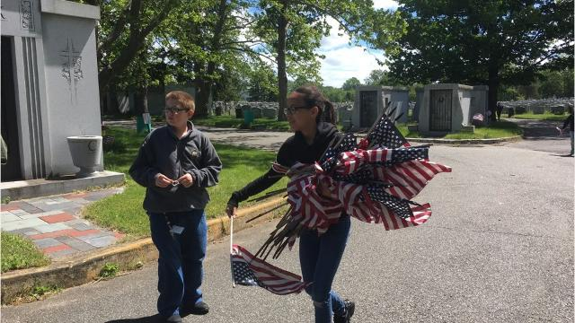 Garfield VFW Post 2867and Blue Star students places 1,800 flags on fallen veteran's graves on May 15, in honor of Memorial Day.