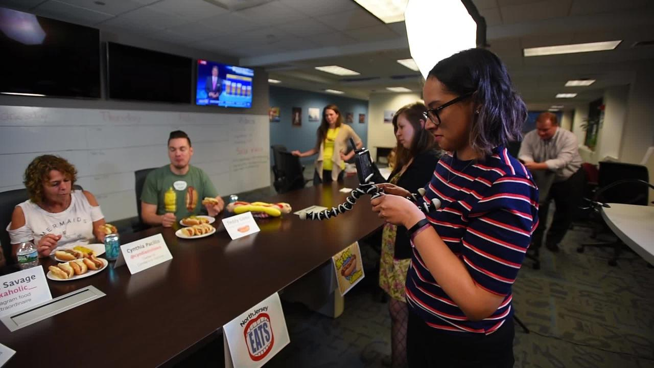 Social Media Editors Elyse Toribio and Kristin Coursen  videograph during the hot dog tasting live show on Facebook and Instagram at The Record in Woodland Park on June 5th, 2017.