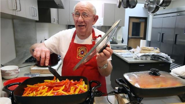 """John Duefrane — aka """"Meatball John"""" or """"Johnny Meatball"""" — has been making his way to each fire station in Kitsap, serving up his meatball subs to the firefighters."""