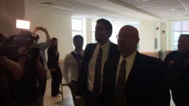 Mark Sievers exits the courtroom