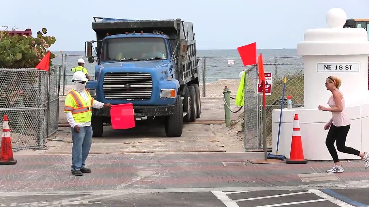 Dump trucks supply sand for largest truck haul beach renourishment in Florida's history