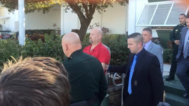 Deputies escort Mark Sievers from LCSO