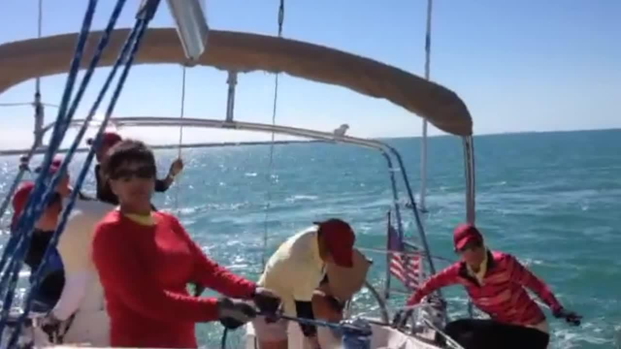 Spinnaker and cruise sailboats race during the first