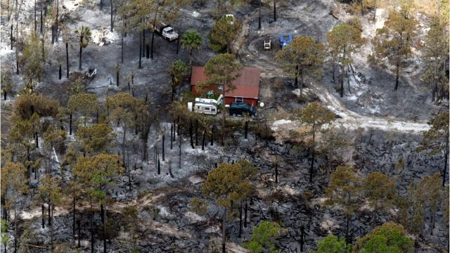 Wind blows Greenway Fire near U.S. 41 and homes southeast of Naples