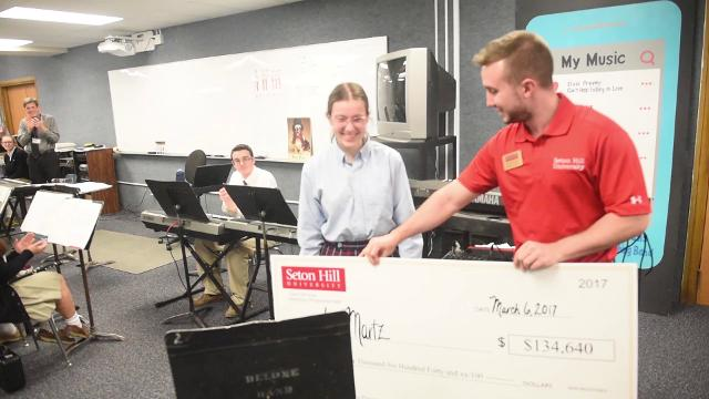 Anna Martz, a senior at Delone Catholic, was surprised Monday, with a full tuition ride to Seton Hill University. She plans on majoring in music therapy.