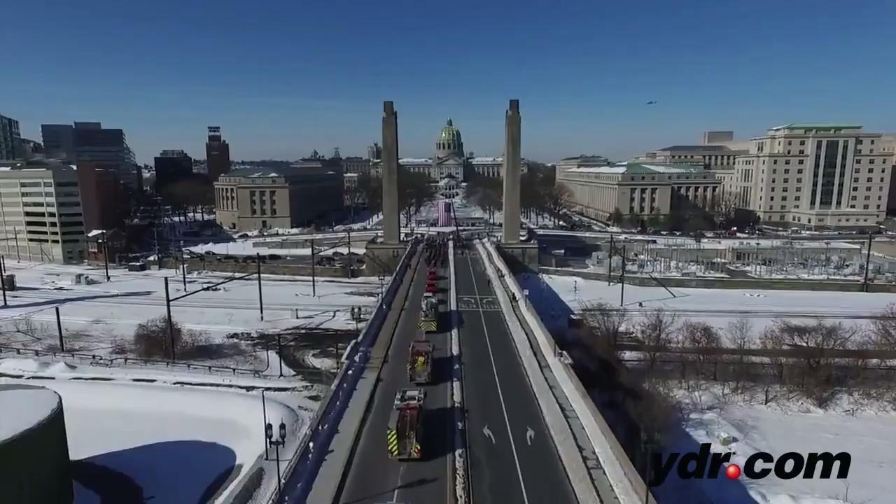 Drone footage of a procession in Harrisburg honoring Lt. Dennis Devoe who was killed in a crash while responding to a fire.