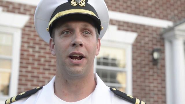 Joshua Corney, a lieutenant in the U.S. Navy, plays 'Taps' every night outside his home to honor service members and their families.