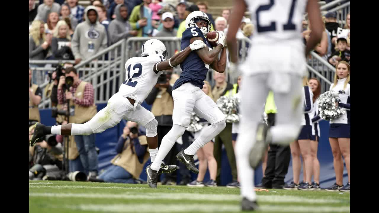 Penn State Ayron Monroe carries the ball after intercepting