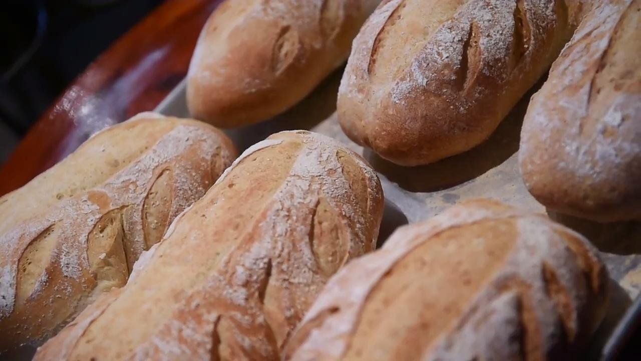 Sean Austin, the owner of the Copper Crust in Central Market, shows how to make a rustic loaf.