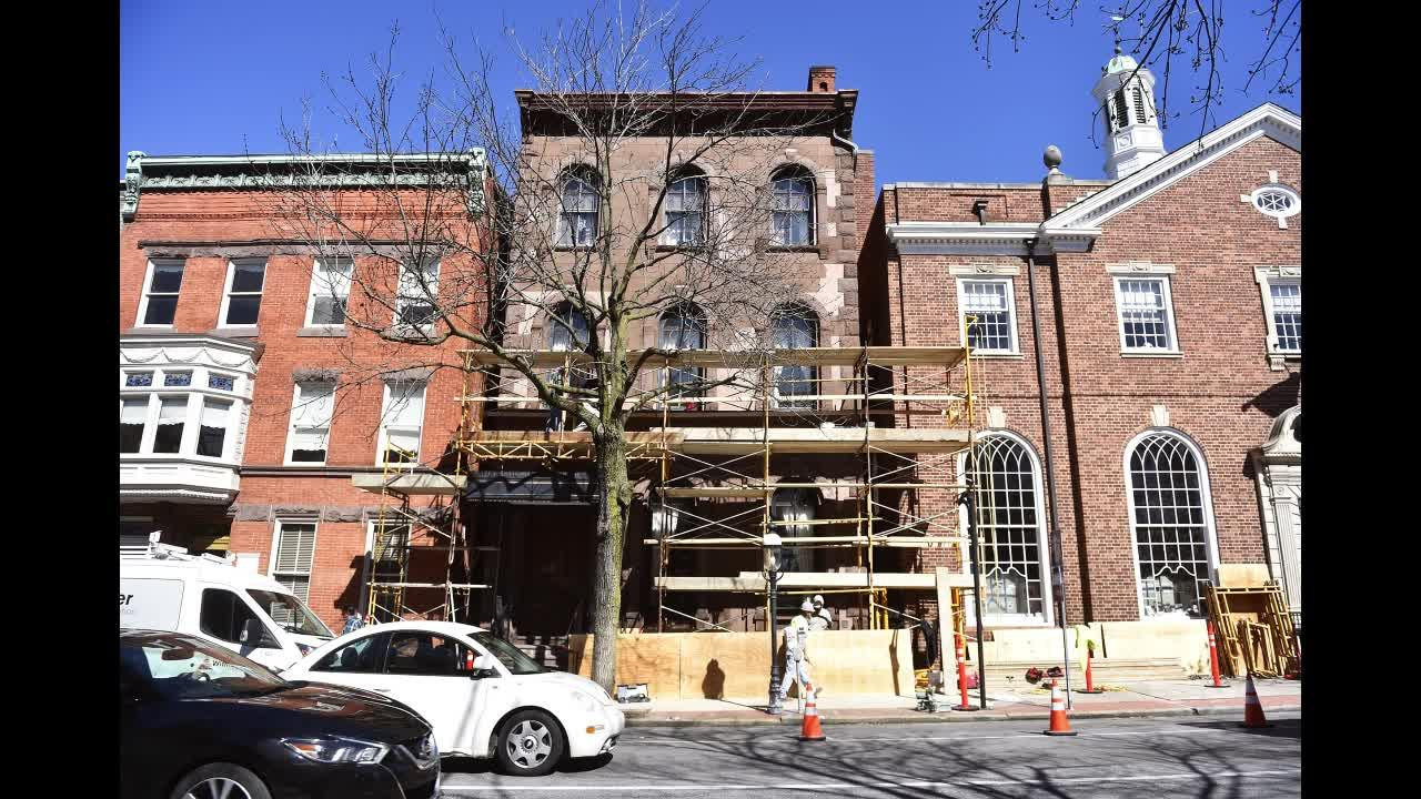 The facade of an 1866 brownstone building that's part of Martin Library was freshened up.