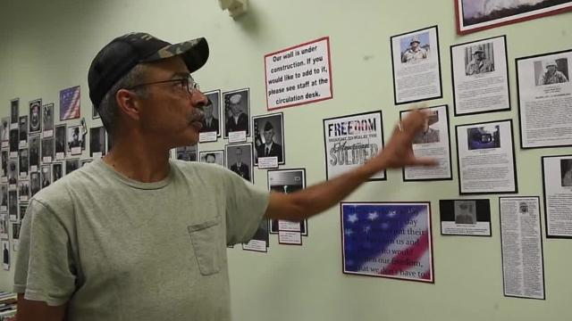 John Norman and other veterans are honored for their military service on walls at Grove Family Library on the Military Honor Wall and History History Wall.