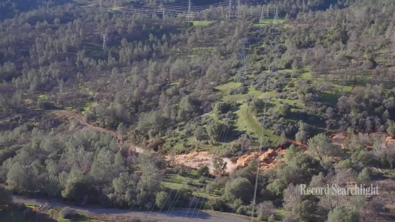 Rebuilt Oroville Dam spillway begins releasing water
