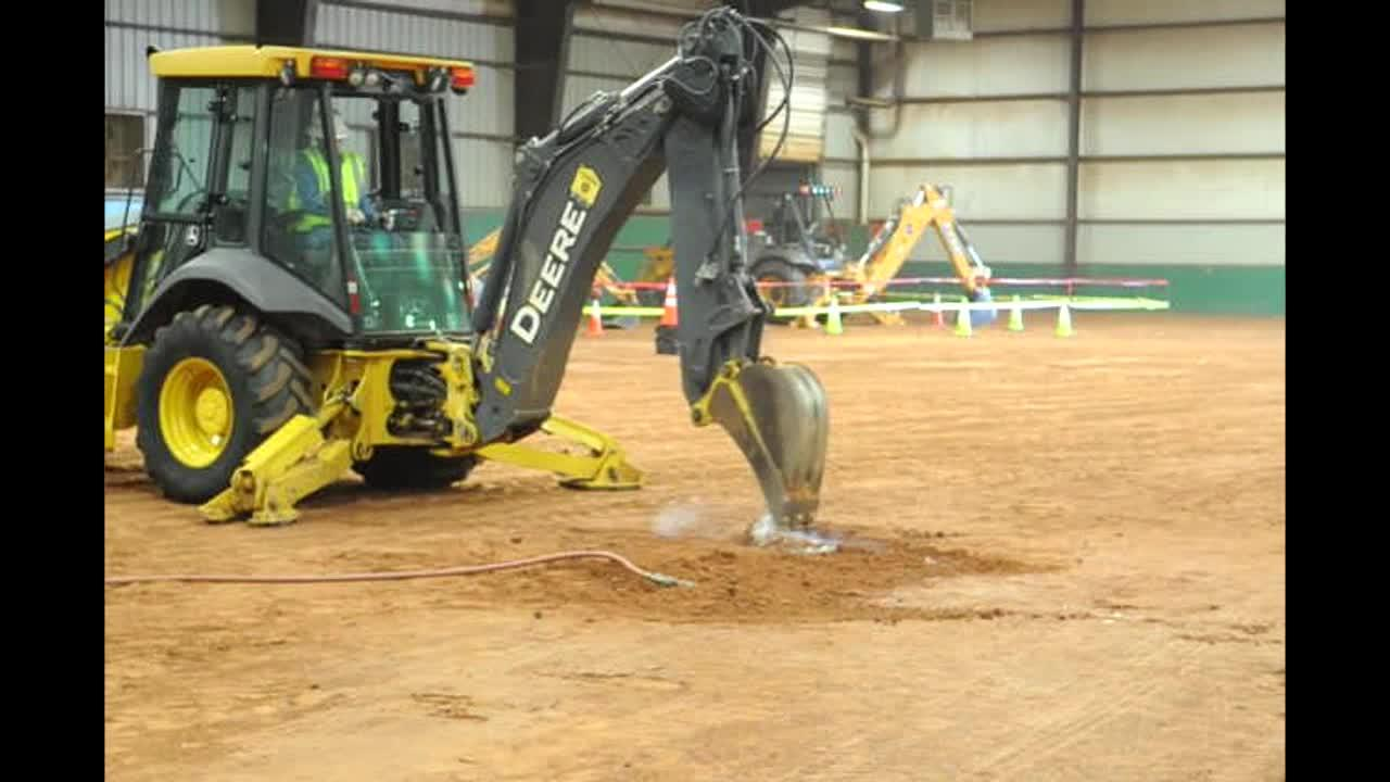 Texas 811 demonstrates striking a natural gas line. Call 811 before you dig.