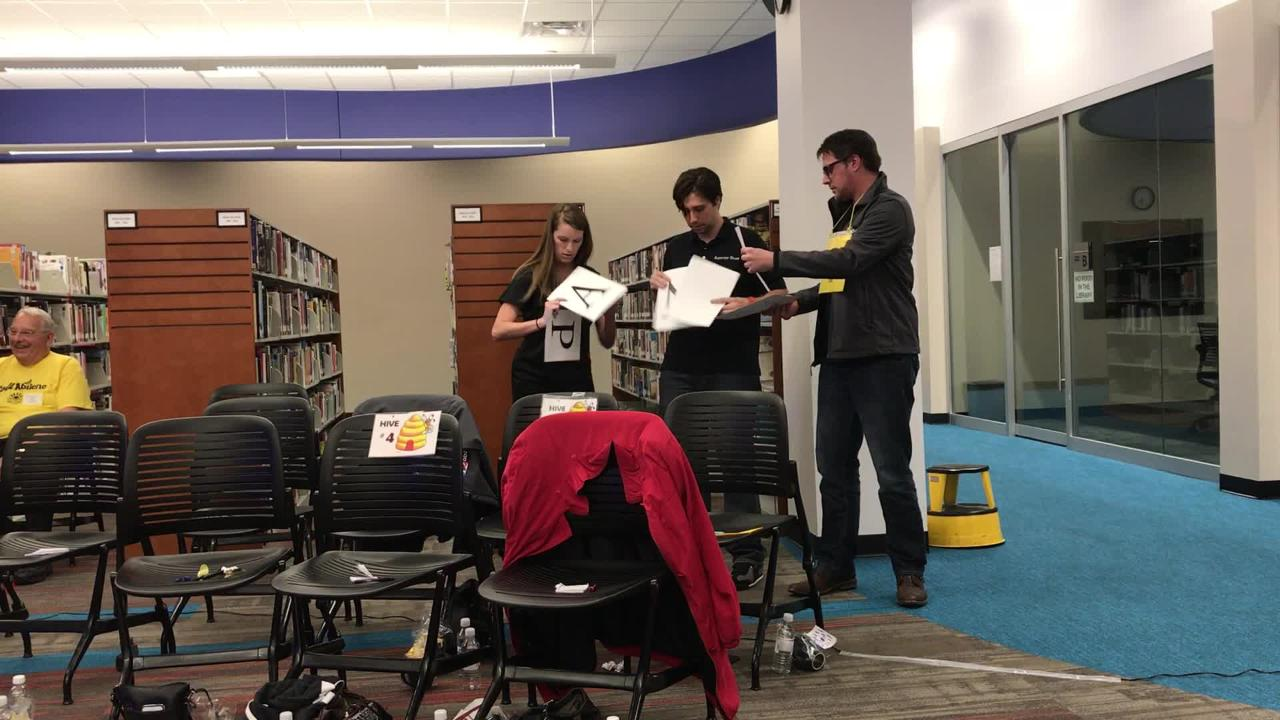 KTXS's Lauren Krivanek, left, and Andrew McMillan, right, needed help from ARN reporter Timothy Chipp at Tuesday's adult spelling bee. The chemistry was a little slow to develop but they eventually succeeded and the KTXS duo went on to win the event.
