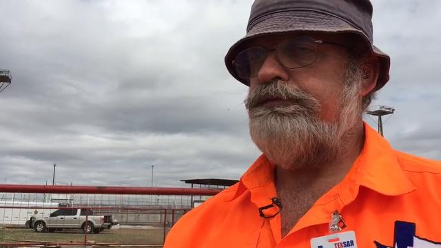 """John Huston of TEXSAR (Texas Search and Rescue) explains the process in which a cadaver trained search and rescue dog """"Orion"""" helped locate a body near the old Texas Speedway area."""
