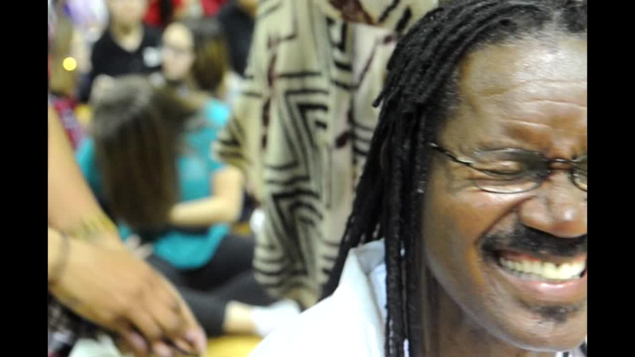 Middle School coach cuts dreadlocks in memory of slain student.