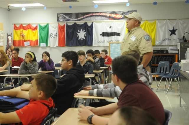 Game warden talks to students at Clack Middle School on Tuesday, March 21, 2017.