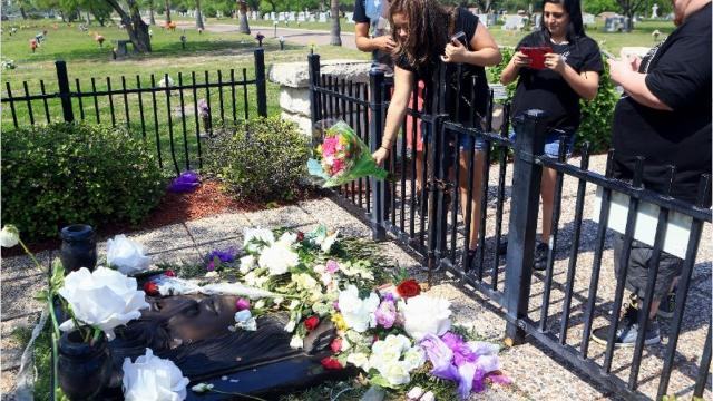 Fans pay their respects to Selena at her gravesite on the second day of Fiesta de la Flor in Corpus Christi.