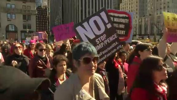 At a protest outside Trump International Hotel on Manhattan's Upper West Side, police say 13 people were arrested for blocking traffic. The protests were part of a nationwide event called A Day Without a Woman. (March 8)