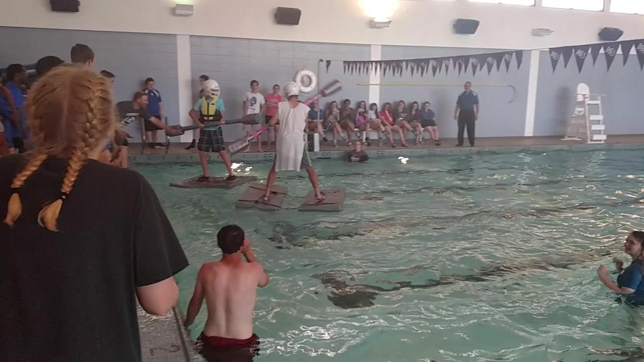 Abilene Christian High School juniors battle for water supremacy in a physics project Tuesday. While it looks violent, the students learned about buoyancy and other physics concepts while also having fun