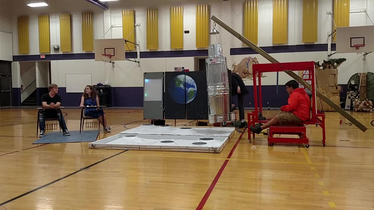 A pneumatic lift is used to transport astronaut Sadie Okerstrom, a freshman at Wylie High School and a member of the Destination Imagination team Galvanized Steel, to the moon.